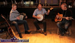 Niall O'Connor (left) with: Tom O'Connell and Cormac O'Mahony playing at the second in the Handed Down series of talks and tunes at the Scartaglin Heritage Centre on Saturday night. ©Photograph: John Reidy