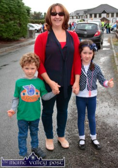 Yvonne O'Connor from Ballymacelligott pictured with her children, Tadhg and Molly in Castleisland for the start of the annual Honda Fun Run in aid of Oileán Beó on Sunday morning. ©Photograph: John Reidy