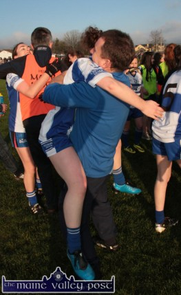 A running jump landed Mariah Curtin into the arms of Desmonds coach, Steve Murphy after their All-Ireland Intermediate Club semi-final win over Kilmacud Crokes in Castleisland on Sunday. in the background, Denny Lyons hugs his daughter, Aoife on their great win. ©Photograph:John Reidy