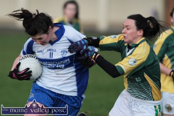 Desmonds centre-back, Cáit Lynch setting up an attacking movement as she gets by the challenge from Southern Gaels corner-back and captain, Cecilia O'Sullivan during their County Senior Football Division 1 League Final in Keel on Sunday afternoon. ©Photograph: John Reidy