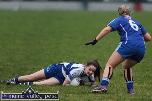 Desmonds full-forward, Leanne Mangan is floored but manages to hold possession as Clonbur centre-back, Aoife Seoighe arrives to challenge her during their All-Ireland Intermediate Ladies' Football final in Corofin, Co. Clare on Saturday afternoon. ©Photograph: John Reidy