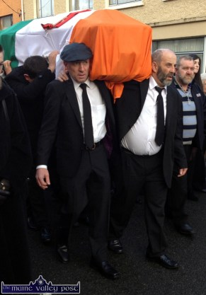 Brothers, Michael and Danny Healy Rae putting in their stint under the coffin bearing the remains of their father the late Jackie Healy Rae through the village in Kilgarvan this afternoon. ©Photograph: John Reidy