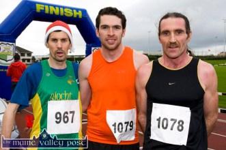 The first three home in the men's race last year were from left: James Doran, An Riocht AC (2nd) Ed Murphy, Gneeveguilla (1st) and his club-mate, John Barrett (3rd) ©Photograph: John Reidy 8-12-2013