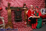 Two of Santa's happy helpers, Cathleen Reidy and Tara Walmsley making preparations for the return of the runners at last year's event. ©Photograph: John Reidy 8-12-2013