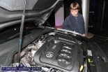 Skye Lynch from Castleisland checking out the engine of the eight generation Passat Variant at the launch at S. Divane & Sons in Castleisland on Friday night. ©Photograph: John Reidy