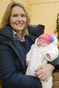 Little Emma Griffin coming to enjoy the concert with her mum Denise.