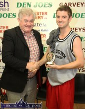 Parental approval: A delighted Ronán is congratulated by dad, Richard Harnett after The Godfathers won their Christmas Blitz division title at Castleisland Community Centre on Tuesday afternoon. ©Photograph: John Reidy 30-12-2014