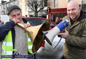 Megaphone diplomacy: Michael O'Leary, Newmarket, Co, Cork (left) and Brian Finucane, Ballylongford limbering up the vocal chords before the Right2Water protest march in Castleisland today. ©Photograph: john Reidy