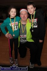 Dan McSweeney, Currow pictured at An Ríocht AC with his children, Lily and Aidan after the Run Rudolph Run 5K Charity event. ©Photograph: John Reidy 14-12-2014