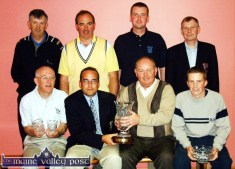 A historic occasion for Castleisland Golf Club on Sunday night as its first captain, Martin O'Donoghue (centre left) presents his prize to Eamon P. O'Connor. Included are: Paul Geaney (left) (4th) and Barry O'Neill (2nd). Back from left: Danno Dennehy, vice-captain; Eamon O'Connor, secretary; James O'Grady, best gross and Andrew Kelliher, club president. ©Photograph: John Reidy 29-6-2003