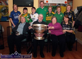 Castleisland Day Care Centre staff members and clients pictured during the visit of the Sam Maguire Cup on Wednesday. Included are: Michael Lenihan, Michael McAuliffe, Eileen Daly and Marie Cronin. Back from left: Helen Greensmyth, Noreen O'Sullivan, Mag Lenihan, Barry O'Mahony, Mary O'Sullivan, Eileen Cronin and Eileen Murphy. ©Photograph: John Reidy
