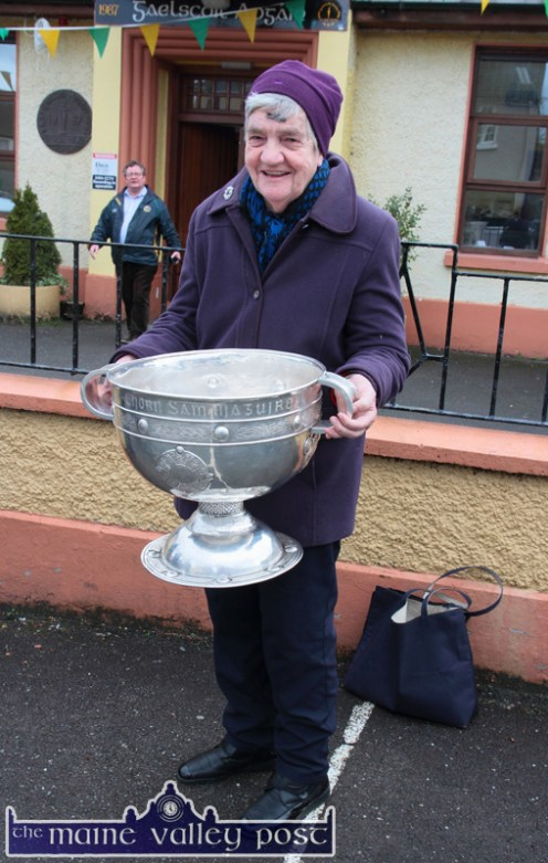 College Road resident, Kathleen Myers was on her way home with her morning's shopping when she bumped into the Sam Maguire Cup during the Castleisland tour on Wednesday: ©Photograph: John Reidy