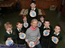 First Class Potters: Potter, Marjorie Cunningham pictured with Scartaglin NS First Class and their completed plates. From left: Michael Horan, Gary Boyle, Maggie Riordan, Eimear Tangney, Dylan Herlihy and Jason Brosnan with Seán Butler at the back. ©Photograph: John Reidy