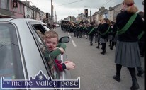 Tommy McCarthy found the comfort of the family car an ideal vantage point to view the 1997 St. Patrick's Day Parade in Castleisland. ©Photograph: John Reidy 17-3-1997