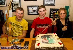 Gearóid, Darragh and Suzanne Curtin pictured after the arrival of the cake at Browne's Bar on Friday night. ©Photograph: John Reidy