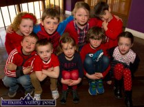 Enthusiastic support for the Glowhearts 4 Crumlin Wear Red Day at Muire Gan Smál in Castleisland on Thursday morning. included are, front: Billy Kerins, DJ Hayes, Nell Hartnett, Con O'Mahony and Lily Broderick. Back: Muireann Hickey, Aaron O'Connell, Siobhán O'Mahony and Tadhg Nolan. ©Photograph: John Reidy