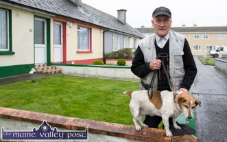 John Cronin brought out his terrier 'Spot' for a photograph after he'd finished spreading fertiliser on his lawn at St. Stephen's Park on Partial Eclipse morning. ©Photograph: John Reidy 20-3-2015