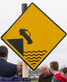 Sign of irony: One of the pair of warning signs on display at Ballykissane Pier with the gathering crowd for Saturday's 99th anniversary commemoration of the drownings. ©Photograph: john Reidy