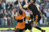 Dr. Crokes' corner forward Colm Cooper in a no-holds barred situation with Austin Stacks' keeper, Martin Moriarty and Stack's wing back, John Dennis during the 2010 AIB County Senior Football final at Austin Stack Park. ©Photograph: John Reidy 17/10/2010