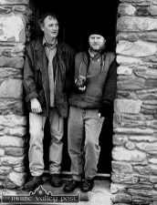 Looking out for better weather: Breanndán Ó Beaglaoch and John Reidy taking shelter during a shoot for Breanndan's CD 'We won't go home 'til Morning' in Baile Na bPoc. Photograph: Ruth Maguire 15-12-1996