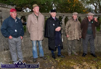 Sheltering from the rain at the War of Independence monument at Castle View, Castleisland on Friday evening were from left: John Mulvihill, Ballyduff; Thomas Harrington, Causeway; Denis O'Reilly, piper, Tralee; Mossie Moriarty, Ballylongford and Michael Vallely, Asdee. ©Photograph: John Reidy 1-5-2015