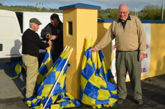 Cordal Flag Men: Neily McAuliffe, Richard O'Donoghue and Tom Wrenn prepare the welcome for the Jamboree Weekend.