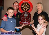Timmy Broderick pictured with his children, T.J. and Nicole and Kathleen O'Connor, The Half Barrel Bar with the new shield awaiting the winners of the inaugural Danny Broderick Memorial Doubles Darts Tournament at The Half Barrel on Sunday. ©Photograph John Reidy