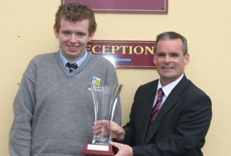Student of the Year, Class of 2015, Conor Browne, Castleisland being presented with his award by Principal, Denis O'Donovan.