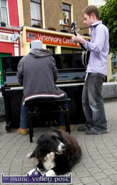 Dog Day Blues: Locals, John McKenna on Piano and Séamus Barra Ó Suilleabháin on Banjo and Jessie the Collie as an audience were part of the colourful and impromptu entertainiment scene on The Square in Listowel during Writers' Week. ©Photograph: John Reidy 1-6-2013