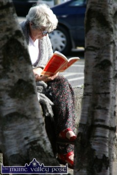 That's Writers' Week for you: A lady totally engrossed in a new found book outside St. John's Art and Heritage Centre in Listowel on Sunday afternoon. ©Photograph: John Reidy 4-6-2006