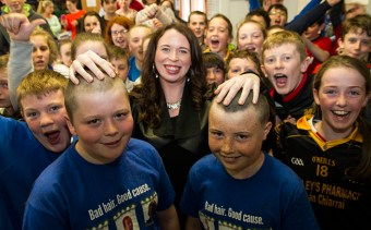 School and Shave or Dye heroes, Luke Regan (left) and his cousin, Conor Walsh with their hairdresser, Christina O'Connor and school-mates after their act of charity at Gaelscoil Aogáin on Friday. ©Photograph: John Reidy