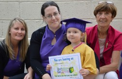 Abbie O'Connor proudly displays her graduation certificate from Bright Beginnings. Included are: Marguerite Egan (left) Susan O'Mahony and Catherine Horan.