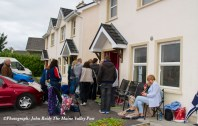 Deposits at the ready, house buyers' all-night vigil comes to an end as the door open at No 8 Cahereen Heights this morning. ©Photograph: John Reidy