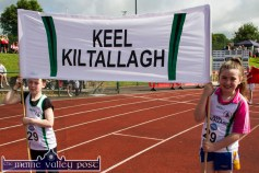 The two Ellens, Griffin and Kelliher carrying the Keel / Kiltallagh colours in the parade at the Denny Kerry Community Games Athletics Finals at An Riocht AC, Castleisland on Saturday morning. ©Photograph: John Reidy