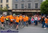 Home are the Heroes: The first bunch of cyclists alight to a great welcome after their 11-hour challenge in the second annual Longest Day Cycle/Climb/Cycle Challenge on Saturday evening. ©Photograph: John Reidy