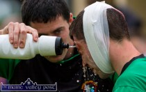 Water Charge: Castleisland AFC manager, Mike McCarthy washing the blood off Mike Hanifin's face during Friday night's drawn Greyhound Bar Cup Final against Listowel Celtic at Mounthawk Park, Tralee. ©Photograph: John Reidy