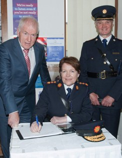 Commissioner Noírín O'Sullivan signing the visitors book before she tours Castleisland Garda Station on Friday with Minister Jimmy Deenihan TD and Supt Pat O'Sullivan. Photograph: Joe Hanley
