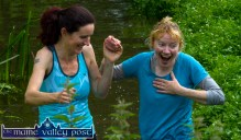 Oh my heart: Mary Lenihan gets a fright but has Ailiís Brosnan in support as they reach the river stage of HercOileán - The Island Warrior Challenge at An Riocht AC in Castleisland on Saturday morning. ©Photograph: John Reidy