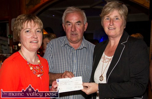 Catherine Murphy (left) and Charlie Farrelly presenting the €1,000 proceeds of the Humphrey Murphy Memorial 5K Road Race to Mary O'Sullivan representing Glebe Lodge at the annual, post races presentation of cheques at Tom McCarthy's Bar on Friday night. ©Photograph: John Reidy