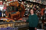 Mrs. Mary Keane pictured beside the famous octagon of the Sive scene in John B. Keane's Bar on Listowel's William Street - where she marked 55 years of trade early in 2010. ©Photograph: John Reidy 19-2-2010