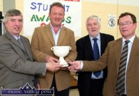 Castleisland Community College past pupil, Mick Galwey receiving a presentation from teaching staff at the college on Friday. Included are: Jack Nolan (left) Eamon O'Sullivan and Colm Kirwan. ©Photograph: John Reidy 27/10/2006