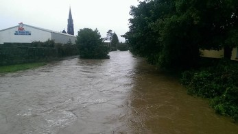 Patsy O'Donoghue's photograph captures the scene from Barrack Street as the River Maine breaks its banks earlier today.