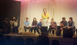 Students performing in 'The Rambling House' scene with Laura O'Connell to the fore.