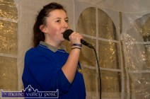 Castleisland Community College student, Grace McCarthy singing carols on stage at the rescheduled Castleisland Chamber Alliance Christmas Street Party on Friday evening. ©Photograph: John Reidy