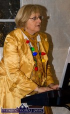 Organist, Helen Tangney pictured in festive gear as she backs carol singer Grace McCarthy at the Castleisland Chamber Alliance Christmas Street Party on Friday night. ©Photograph: John Reidy