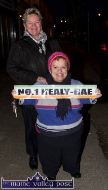 Sisters, June McCarthy front and Maureen Coffey waiting for the Healy Rae cavalcade in Castleisland on Sunday evening. ©Photograph: John Reidy