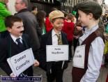 Gaelscoil Aogáin pupils: Seán Ó Briain le Sadie Ni Bhrosnacháin agus Katie Nic Choitir after their Easter Rising 1916 stint at Thursday's St. Patrick's Day Parade in Castleisland. ©Photograph: John Reidy