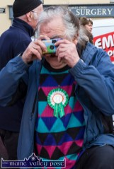 Tom Conway from Tralee capturing all the action at Thursday's St. Patrick's Day Parade in Castleisland. ©Photograph: John Reidy