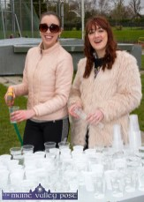 Preparing the water stand for the return of the athletes were: Niamh McSweeney and her sister and An Ríocht AC manager, Kate, at the annual An Riocht AC / Lee Strand Kingdom Come 10 Miler and 5K Road Race in Castleisland this morning. ©Photograph: John Reidy