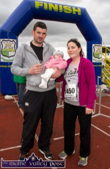 Christine O'Hanlon, Ballymacelligott with her partner, David Moynihan, Scartaglin and Baby Edel pictured after the annual An Riocht AC / Lee Strand Kingdom Come 10 Miler and 5K Road Race in Castleisland this morning. ©Photograph: John Reidy